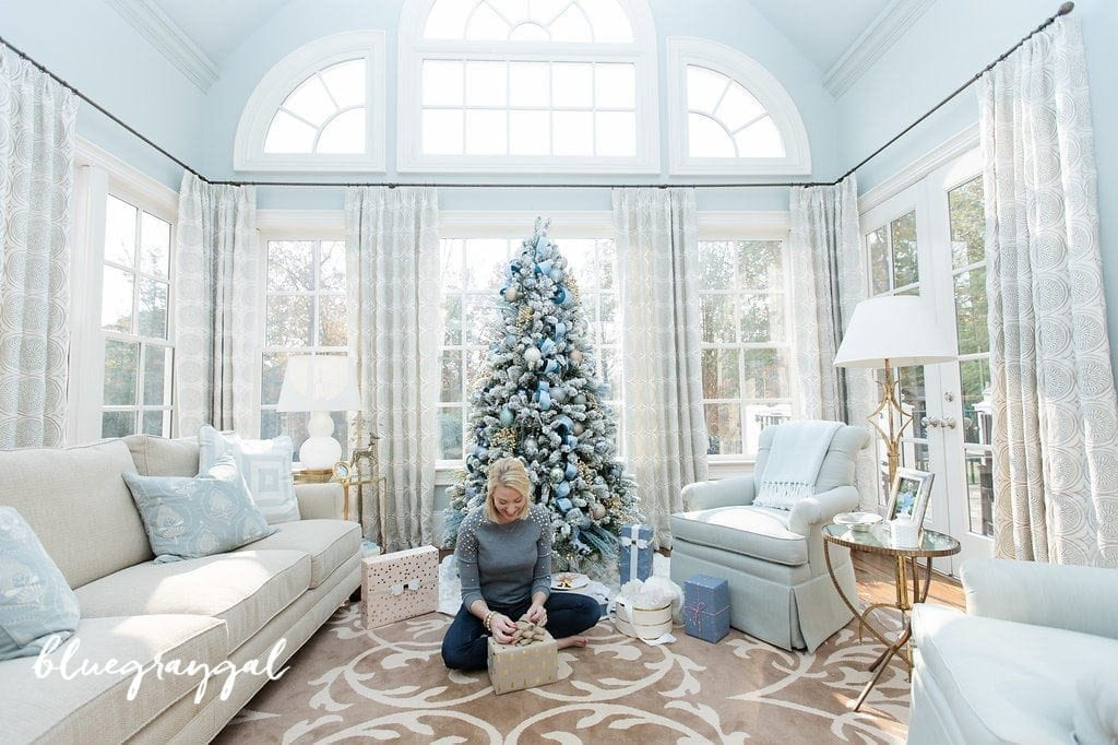 bluegraygal wrapping presents beneath christmas tree in her home