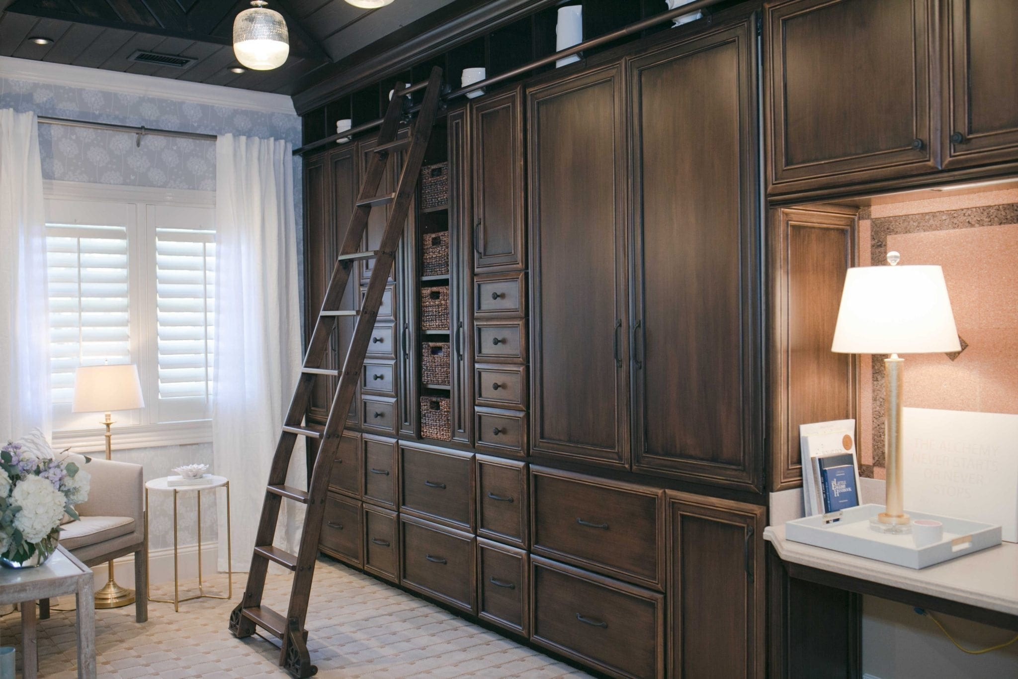 peel and stick wallpaper in dark office with dark wood built ins and library ladder