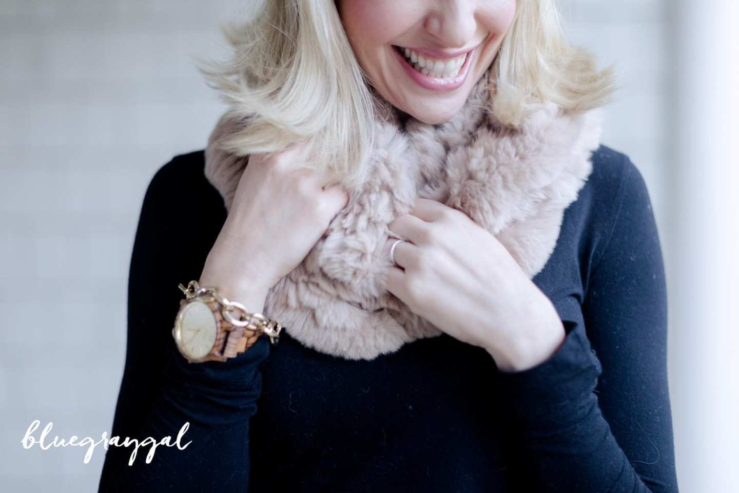 Rabbit fur scarf and wooden watch.