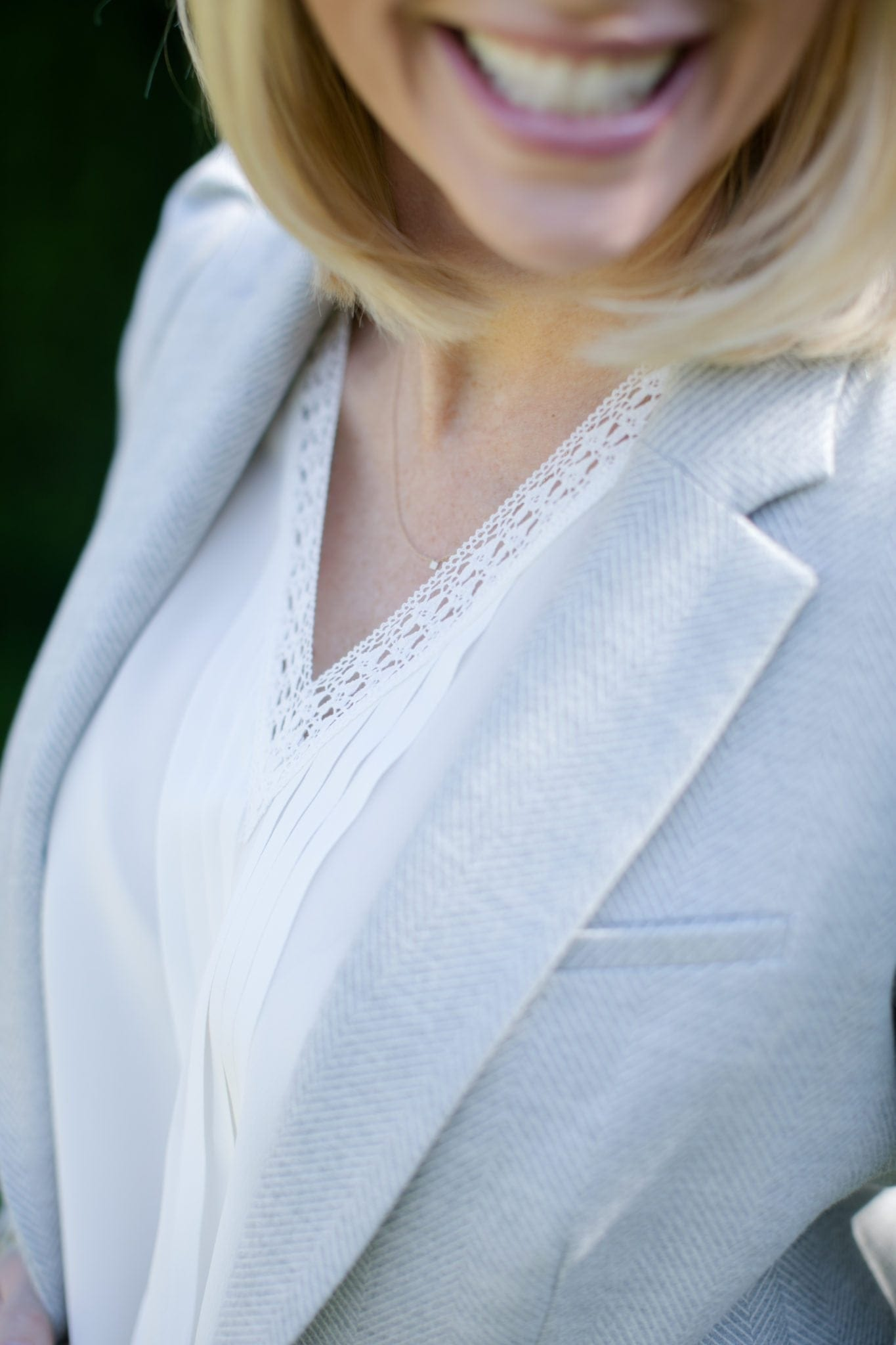 white lace joie blouse with light blue blazer and blonde hair for casual spring look
