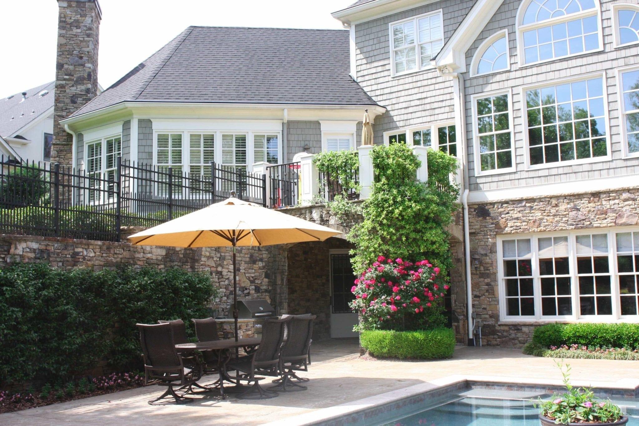 Backyard pool landscaping ideas. Jasmine vine and knockout roses.