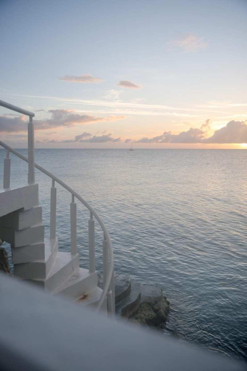 Four Seasons Anguilla and Caribbean ocean at sunset.
