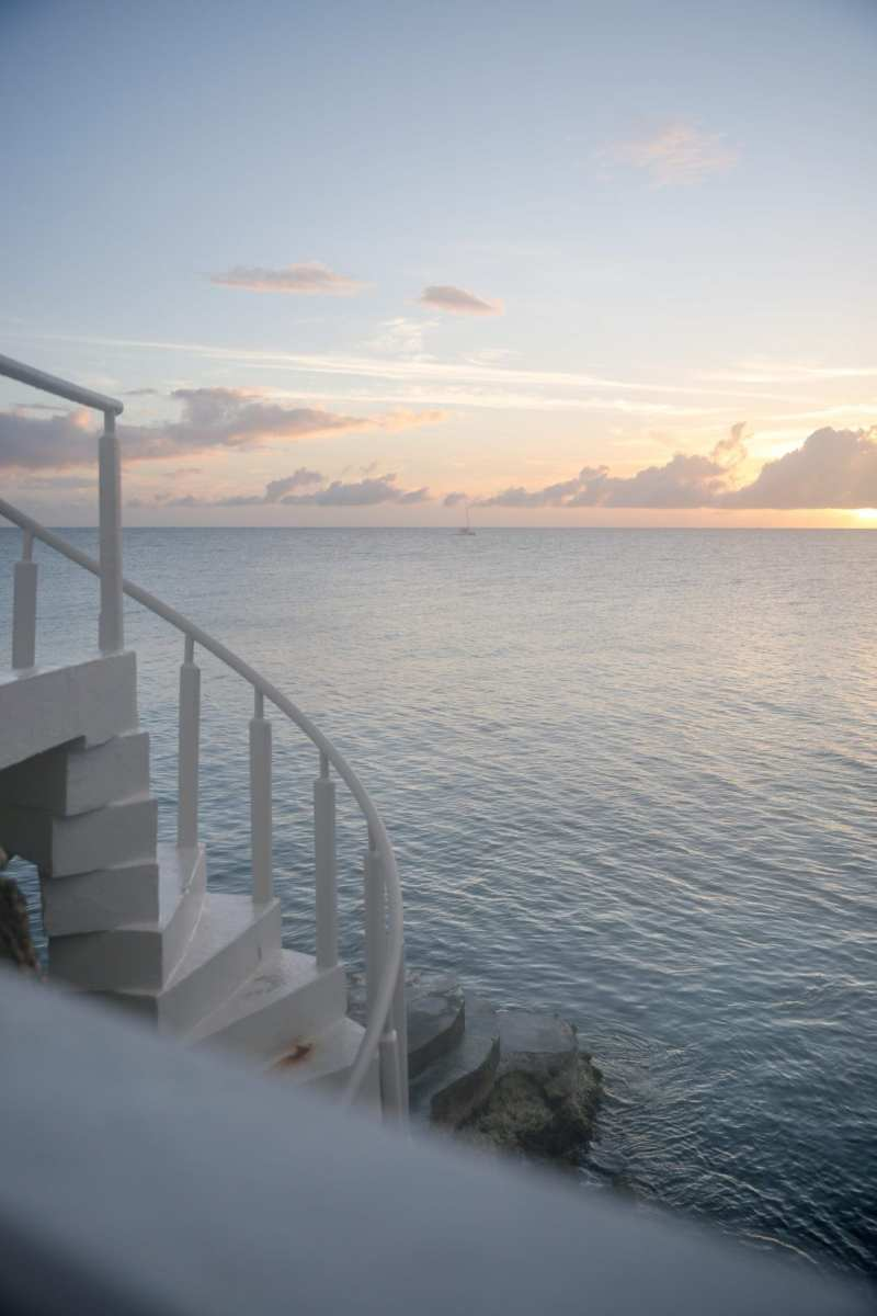 Four Seasons Anguilla and Caribbean ocean at sunset.