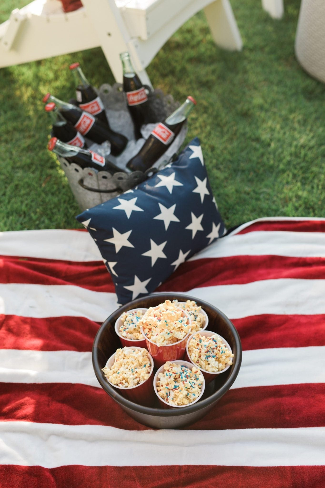 Fourth of July tablescape and 4th of july party ideas with red white and blue party decor.