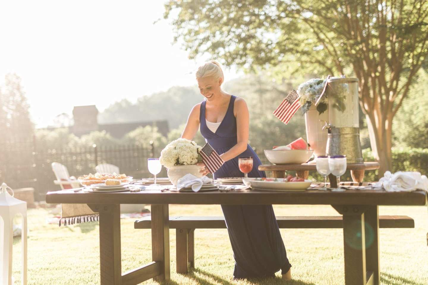 Get table centerpieces for party inspiration like this fourth of july decor with red white and blue table settings