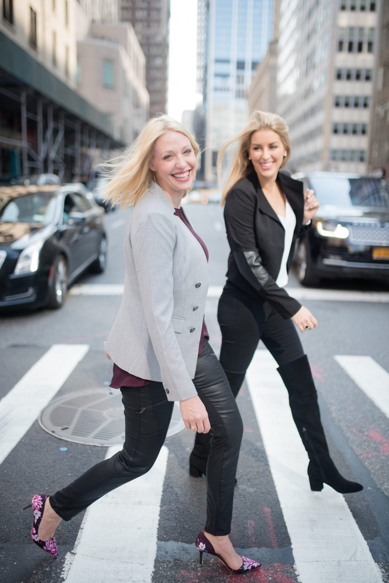RewardStyle Like To Know It bloggers Jess Cathell and Kelly Page walking across the street in NYC with floral pumps and over the knee boots.