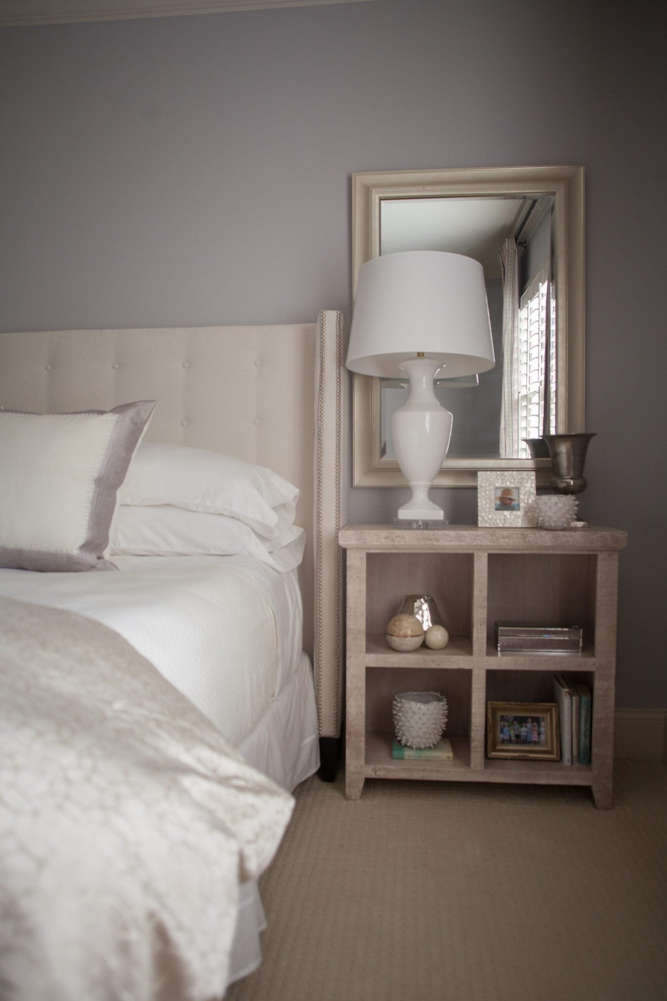 Bleached wood nightstands and white table lamps.