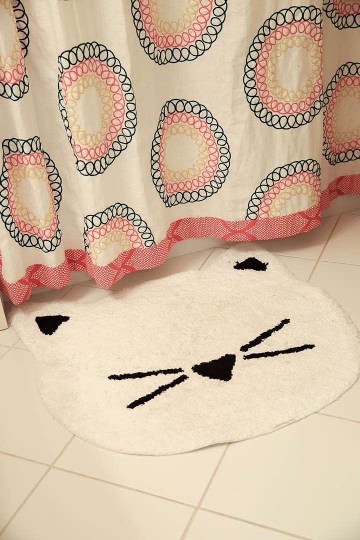 White kitty bathroom mat. Pottery Barn Kids bathroom decor for kids.