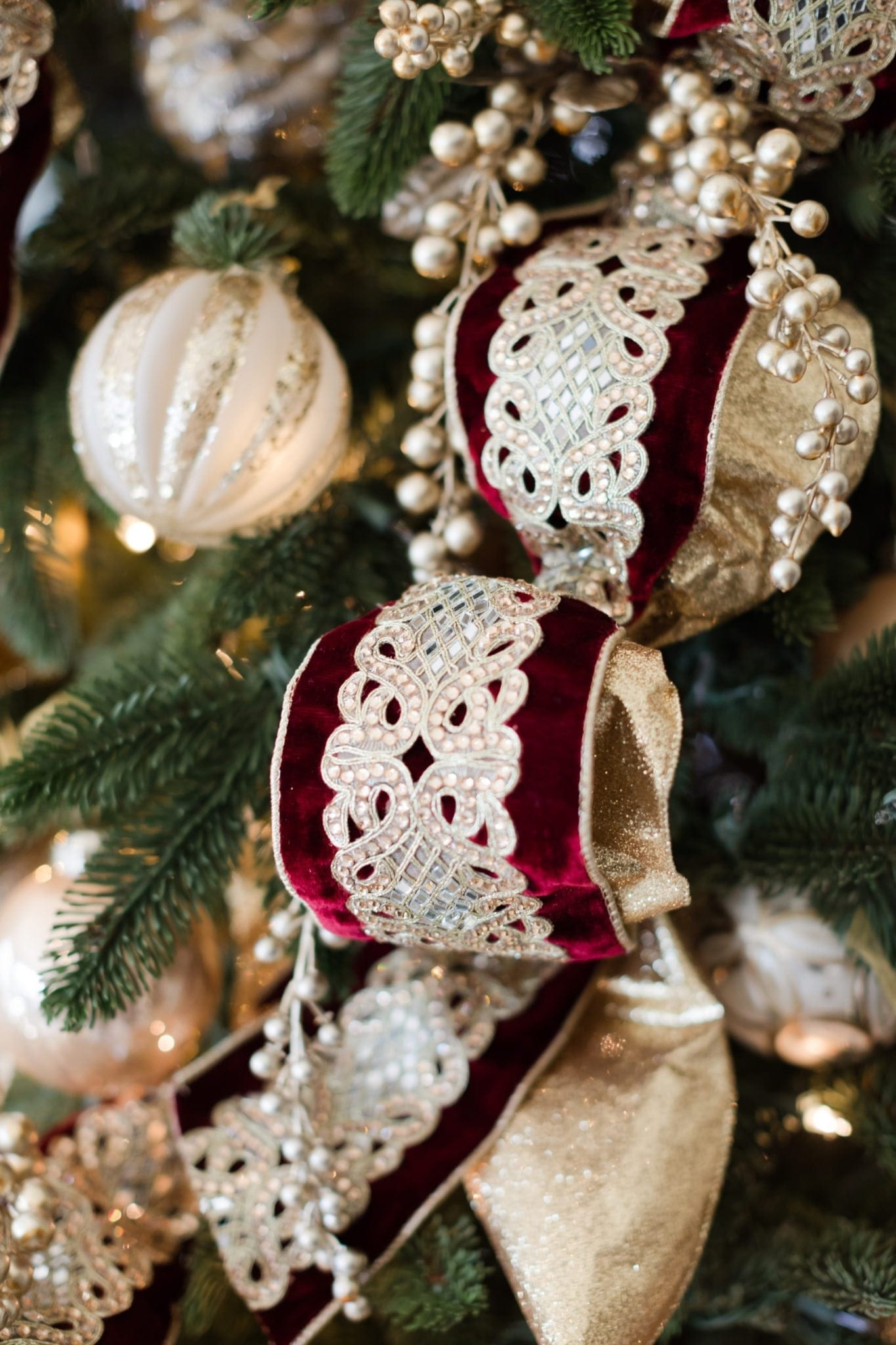 Maroon and gold Christmas ribbon with gold ornaments.