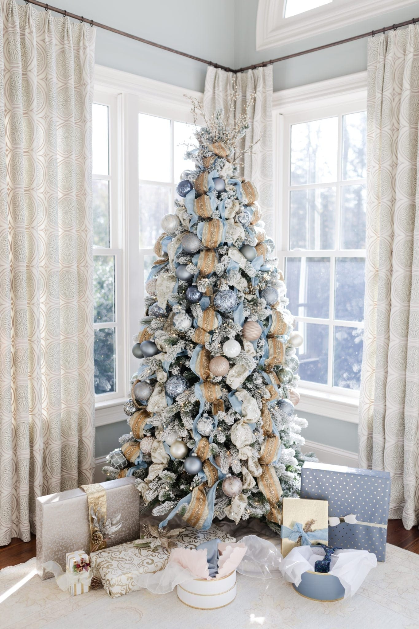 Gold and blue Christmas tree. Holiday inspiration for decorating for Christmas with blue and gold.