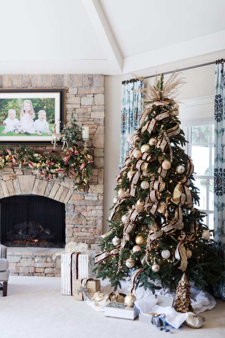 Gold and Red Christmas tree ideas. Southern style holiday decor with stone fireplace decorations.