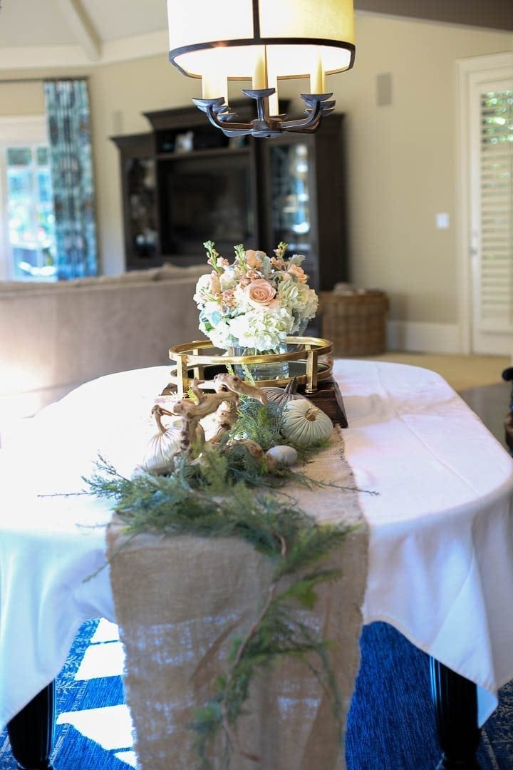 Buckhead flowers - Carithers flowers on burlap runner with greenery and pumpkins for fall tablescape decor.