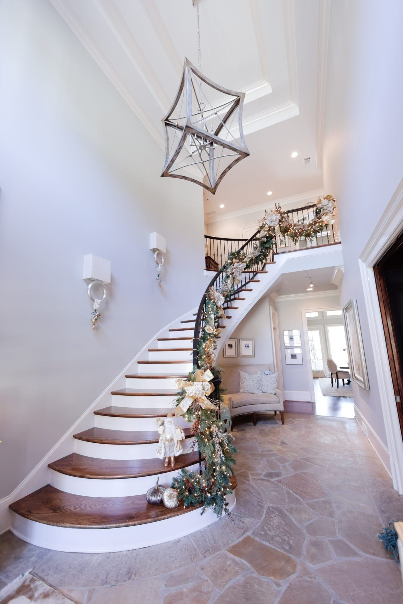 Decorating for Christmas with banister garland. How to hang garland on a staircase.
