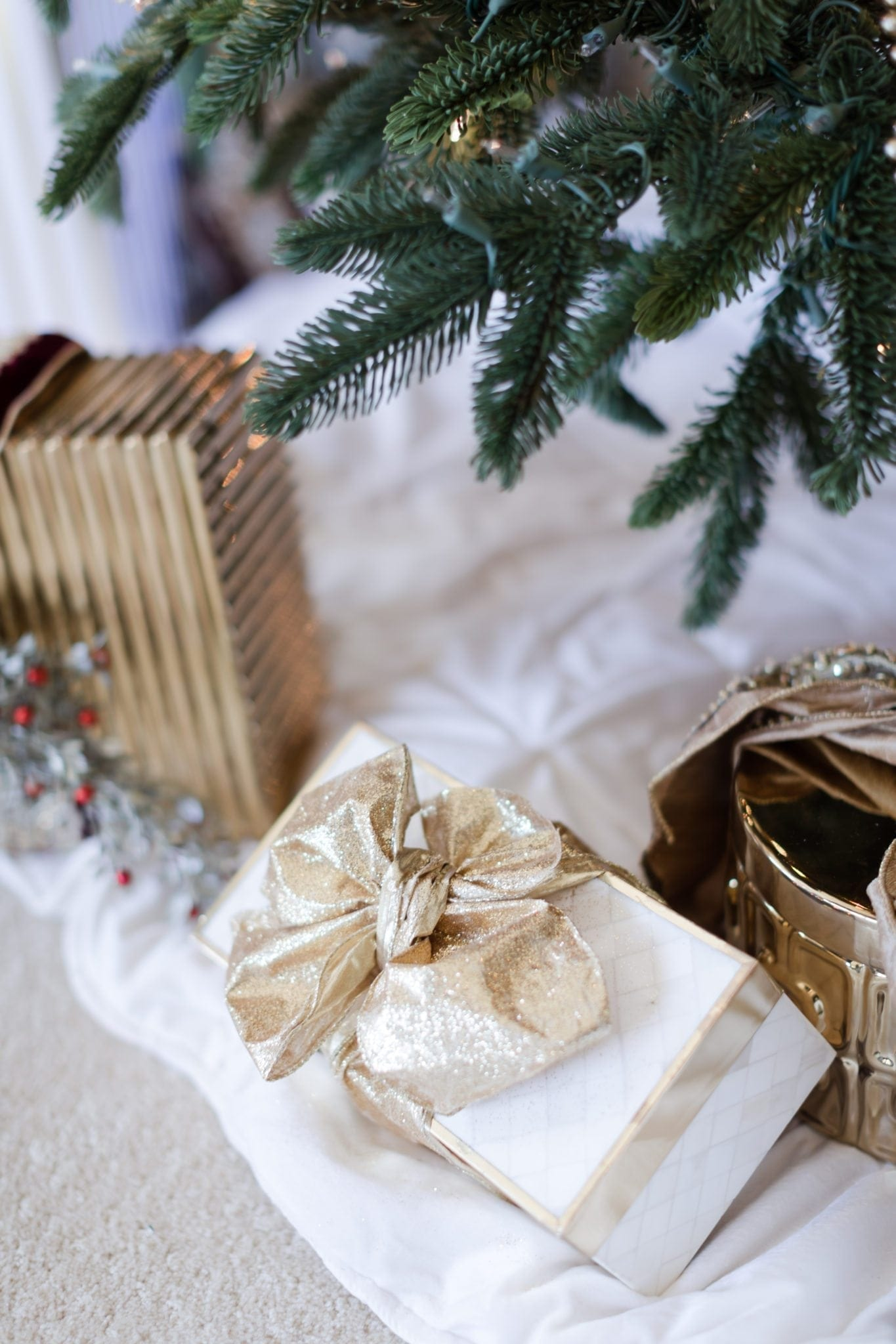 Gold ribbon wrapped present. Gold glitter ribbon.