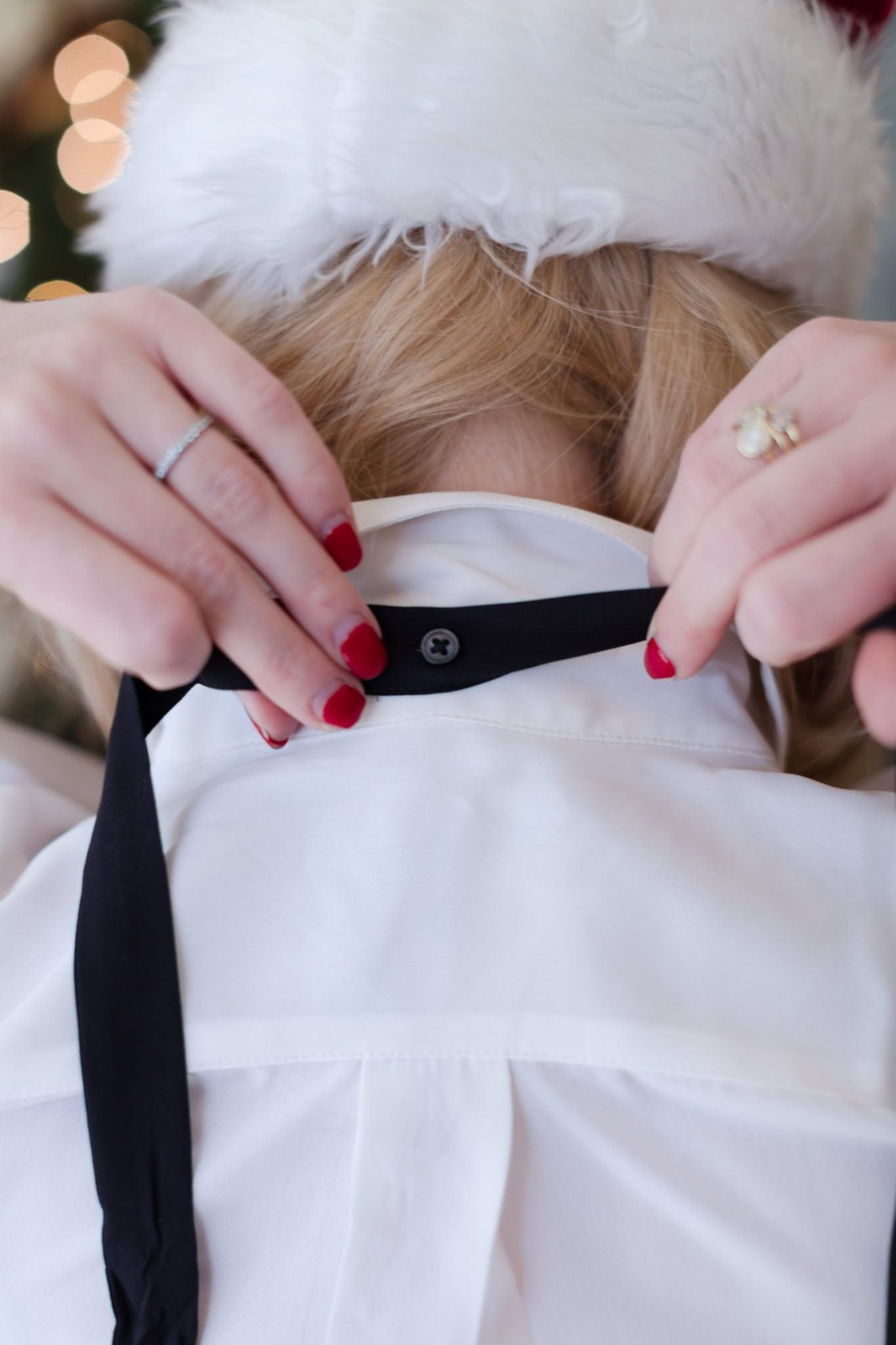 White blouse outfit idea with black neck tie.