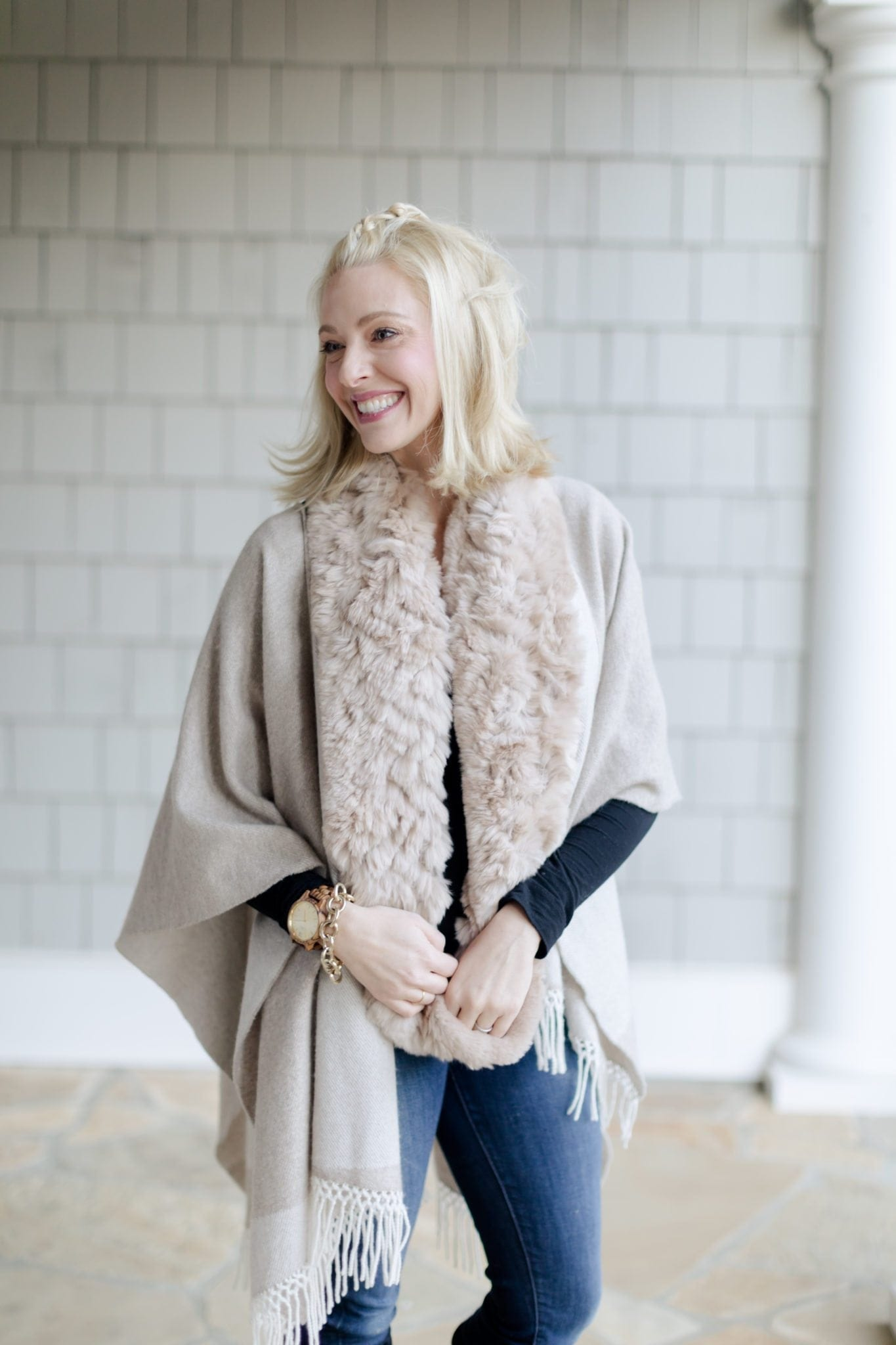 Stylish women's ponchos and capes are so versatile for all winter temps. This pretty outfit also has a real fur scarf paired with knee high suede boots!