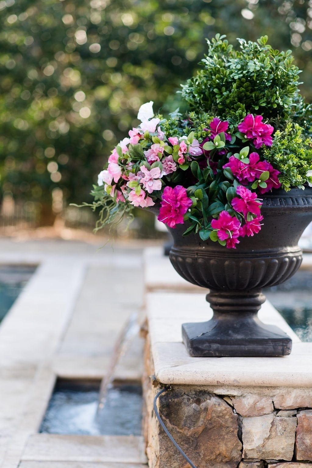 Silk Petunia plans in pool garden container with plastic boxwood.