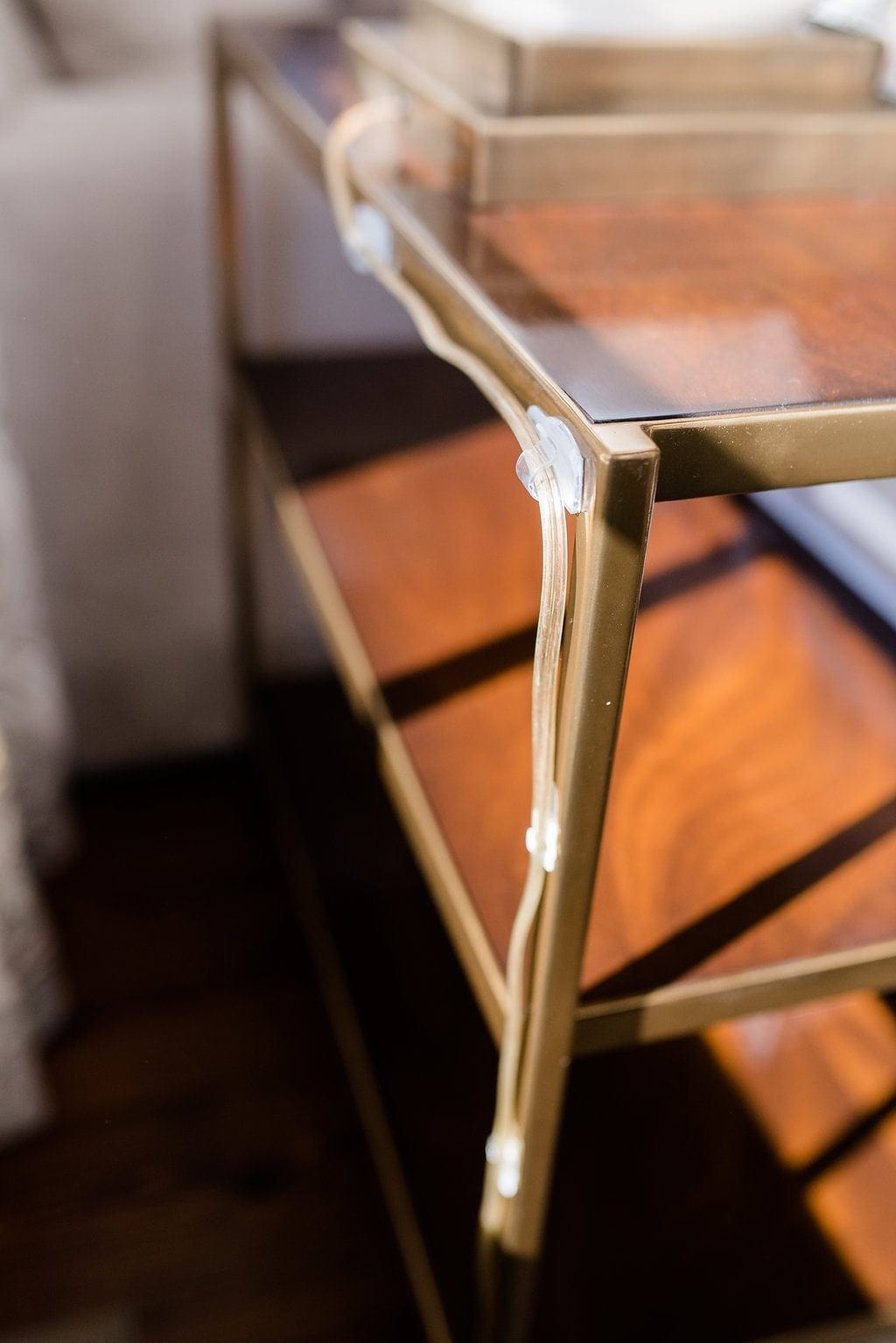 Command hooks to hide lamp cords on the back of furniture.