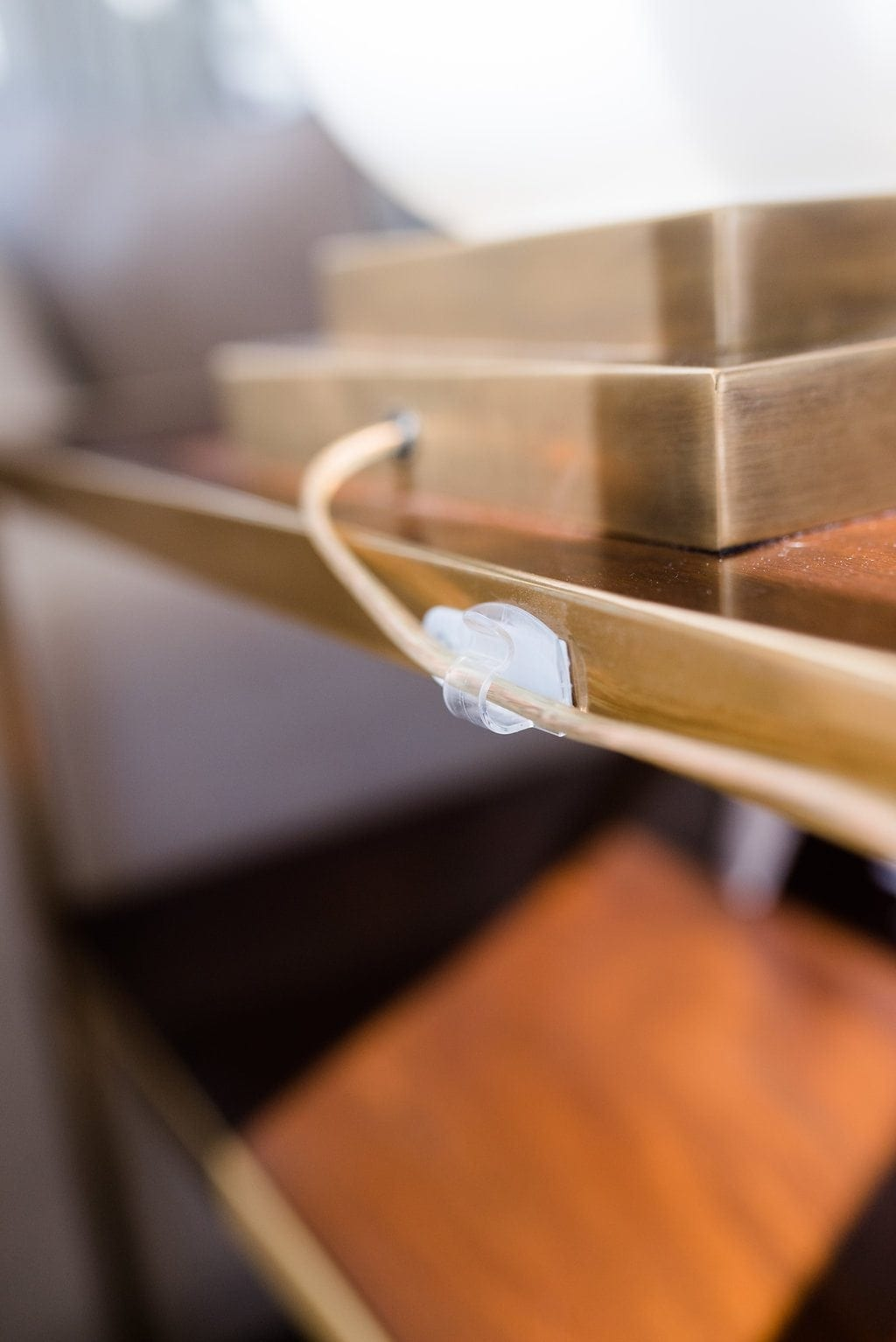 Easy tips to hide cords in your house and keep cords out of view when decorating.