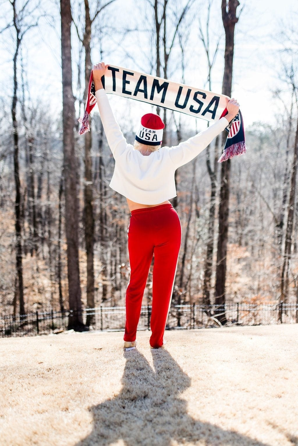 Red jogging pants and US Olympic team scarf.