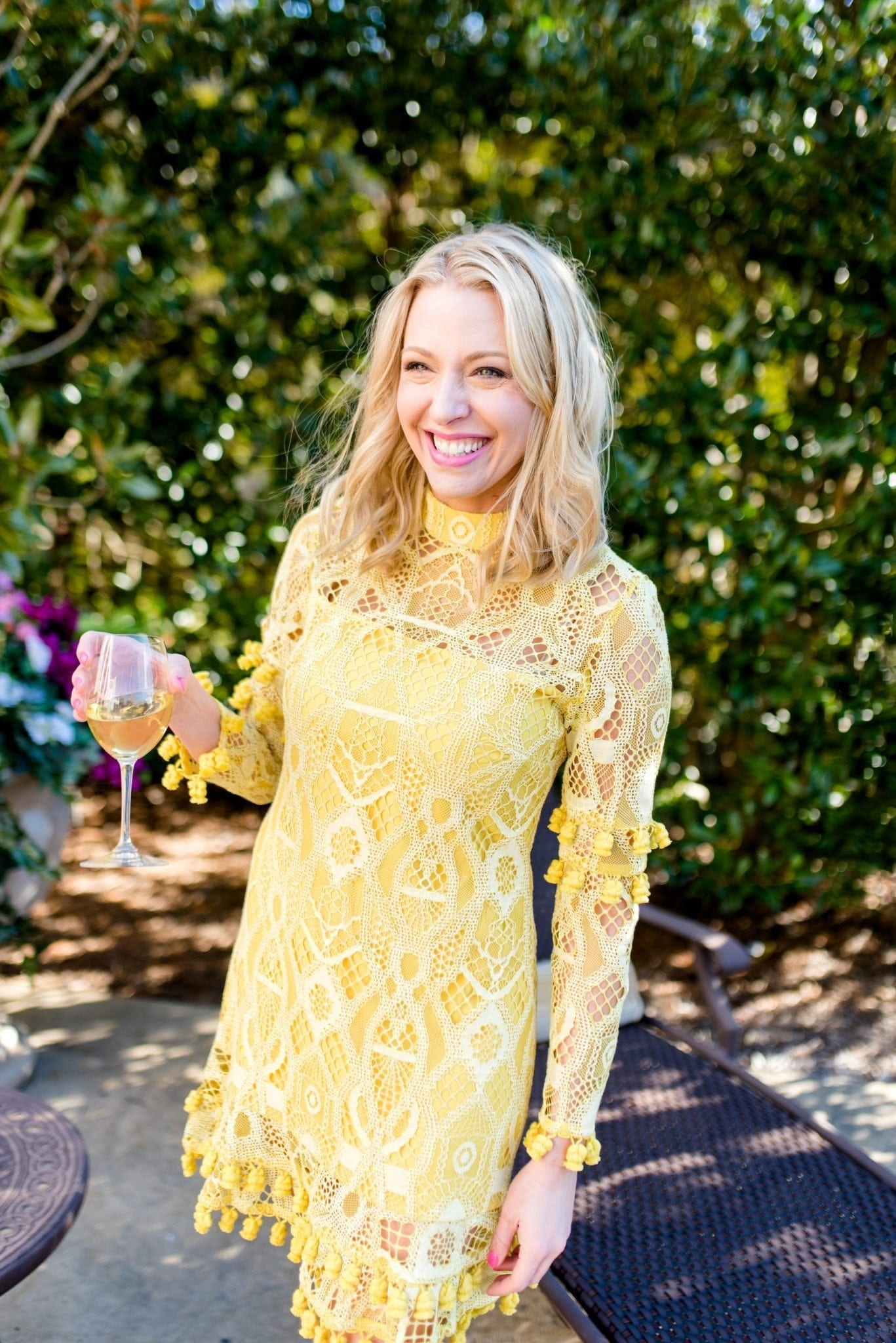 Yellow lace dress by Alexis. Perfect dress to wear to a spring or summer wedding.
