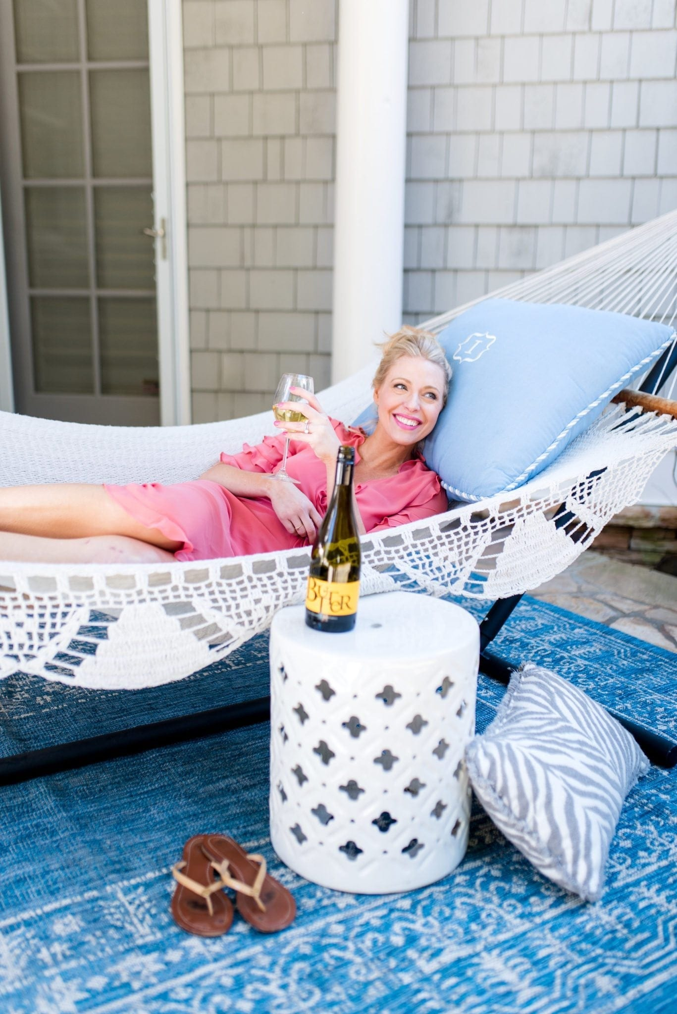 Outdoor Hammock, blue outdoor pillow, white garden school and great ruffle maxi dress.