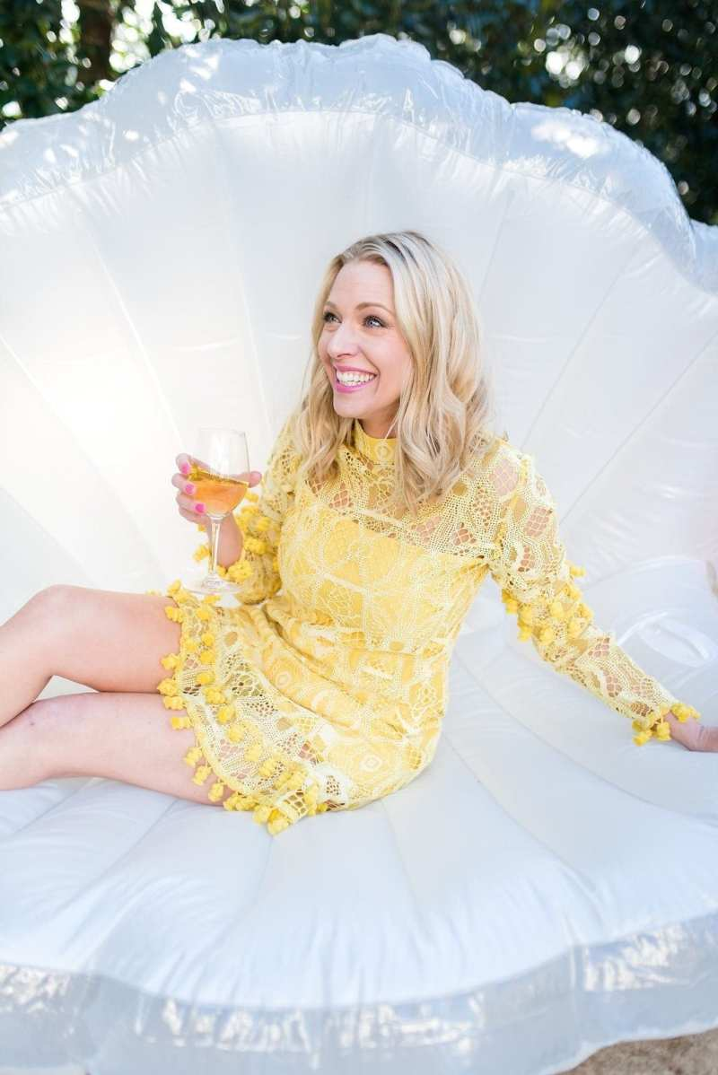 Oyster pool float with pearl. Yellow Alexis dress.