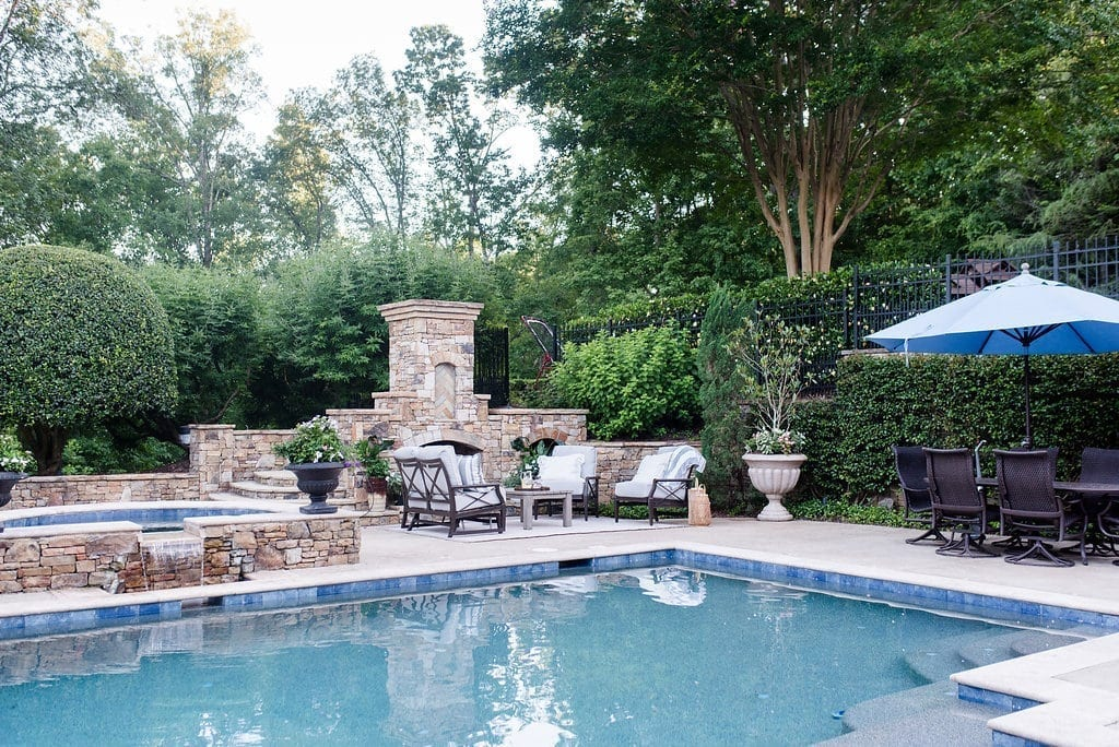 Atlanta backyards and Pebble Tech swimming pool. Outdoor fireplace and landscaping ideas.