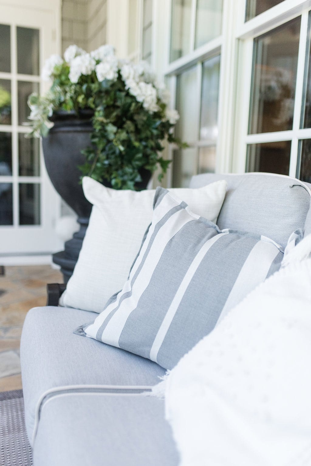 Gray outdoor throw pillows. Gray and white stripes. How to decorate outside.