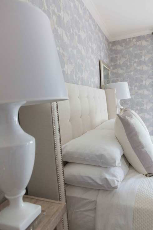 Bedroom Wallpaper Ideas. Light purple and gray wallpaper and white lamps with ivory headboard.