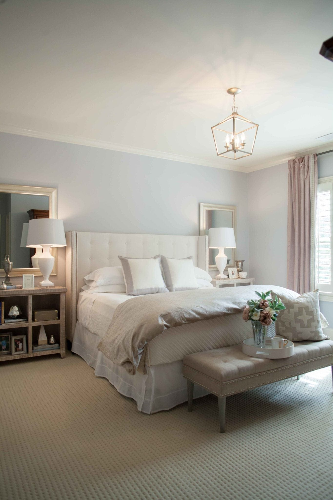 Neutral bedroom decor in shades of purple, lavender and gray.