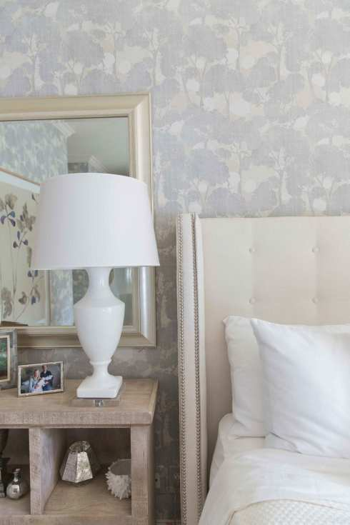 Purple and ivory bedroom design. Ivory headboard and white table lamps. Soothing bedroom.