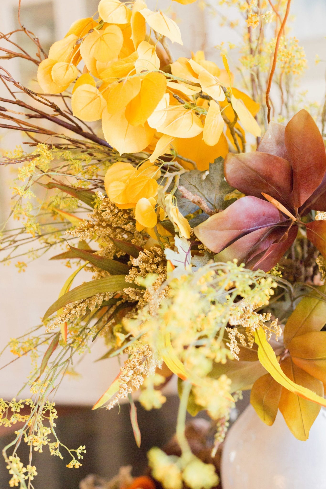 Thanksgiving Tablescape with yellow flowers and gold heather.