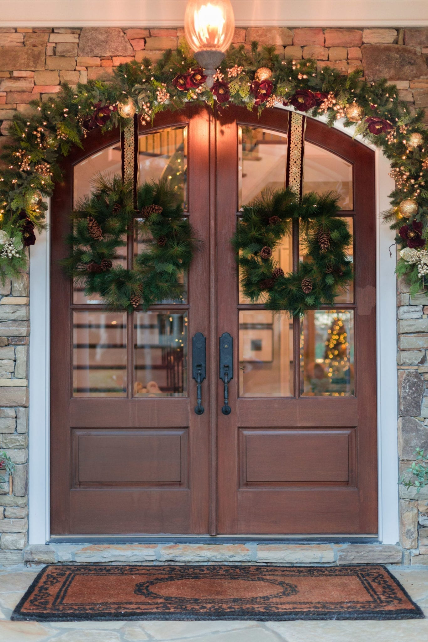 How to Hang Garland on Stone Outside. Front door holiday decorating with wreaths and garland.