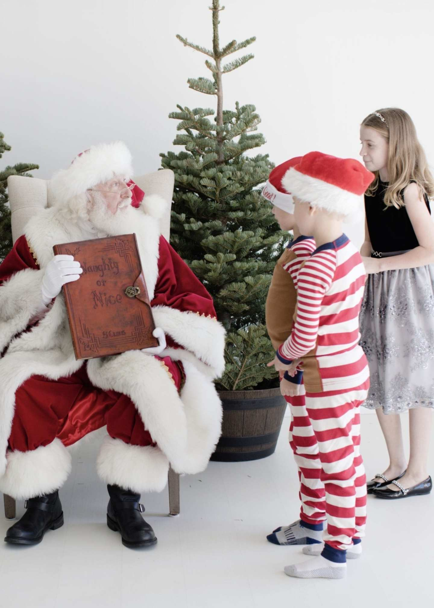 hanna andersson christmas Pjs and Monsoon Atlanta girls formal dress for pictures with Santa.
