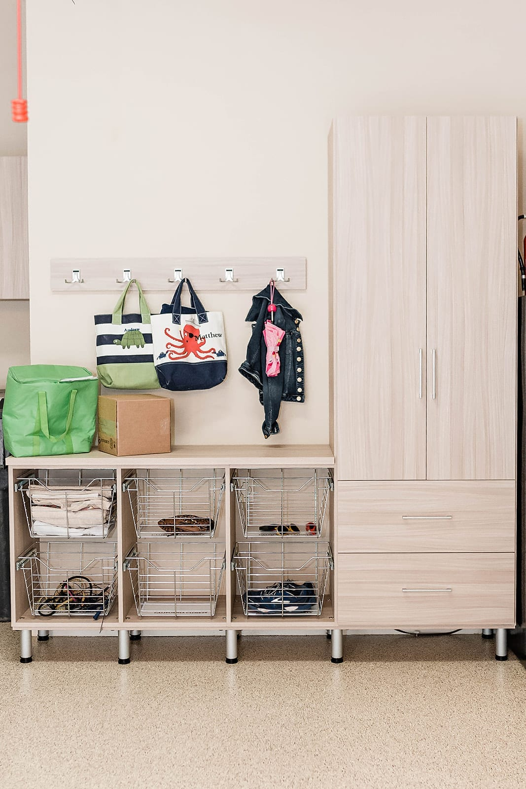 Garage Cabinet Ideas - adding a counter top and baskets to keep things easy to find in the garage for kid stuff.