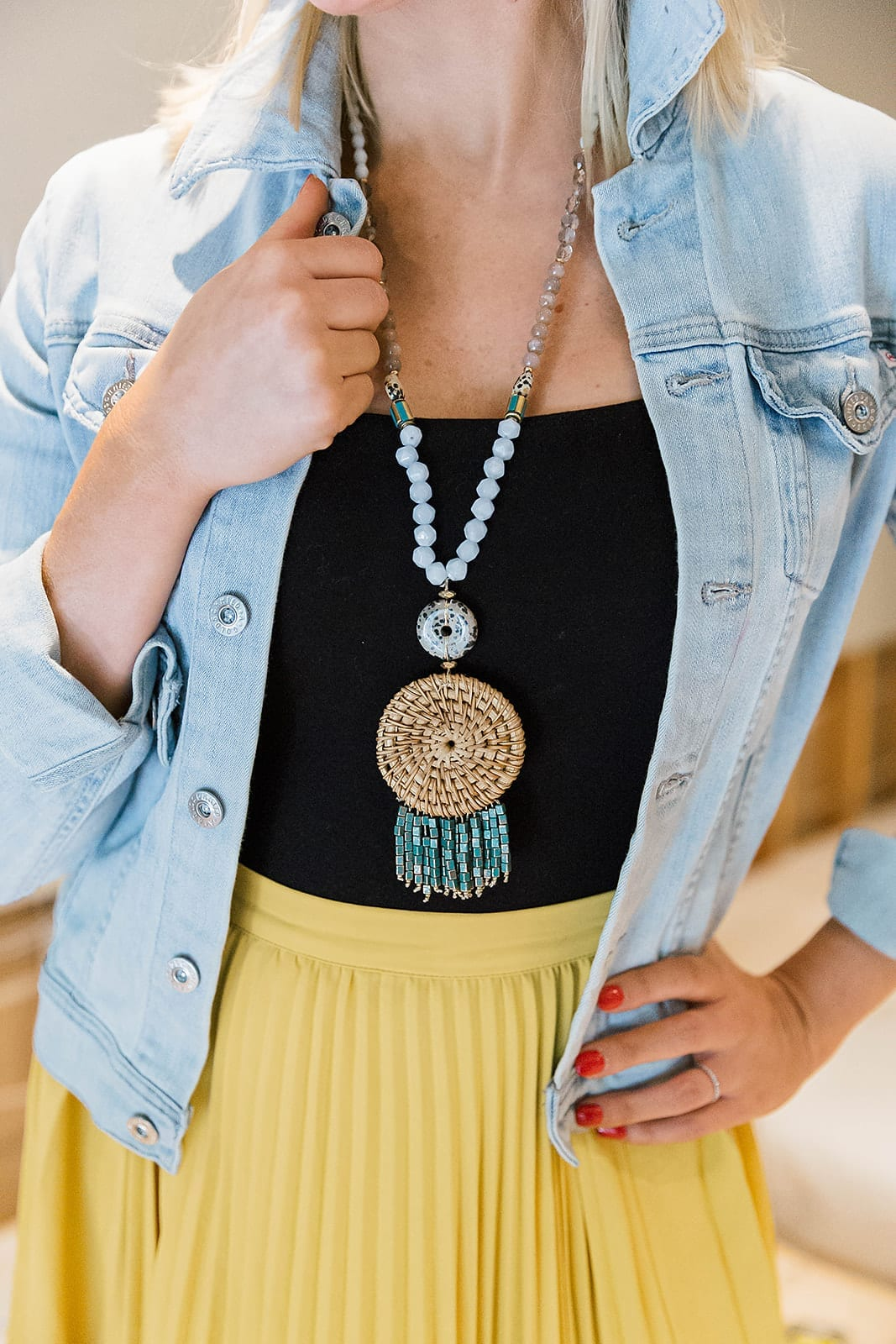 Statement Anthropologie necklace on sale! Gorgeous dream catcher necklace with blue beads and distressed cropped denim jacket with yellow skirt.