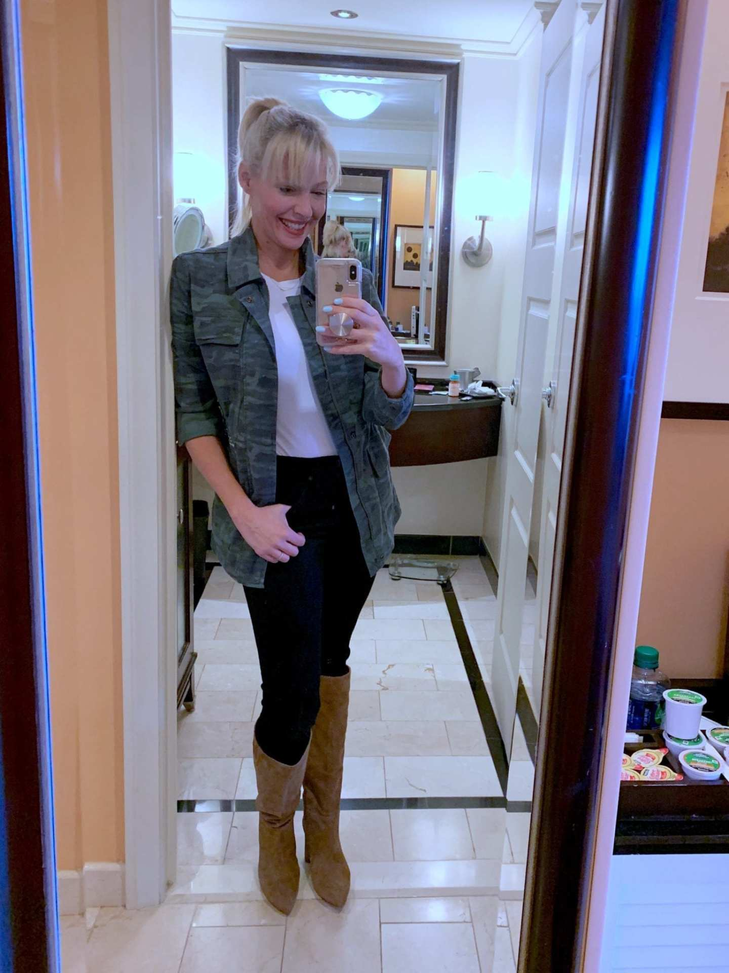Camo Jacket on Sale with black jeans and tan suede knee high boots. Fall fashion on sale.