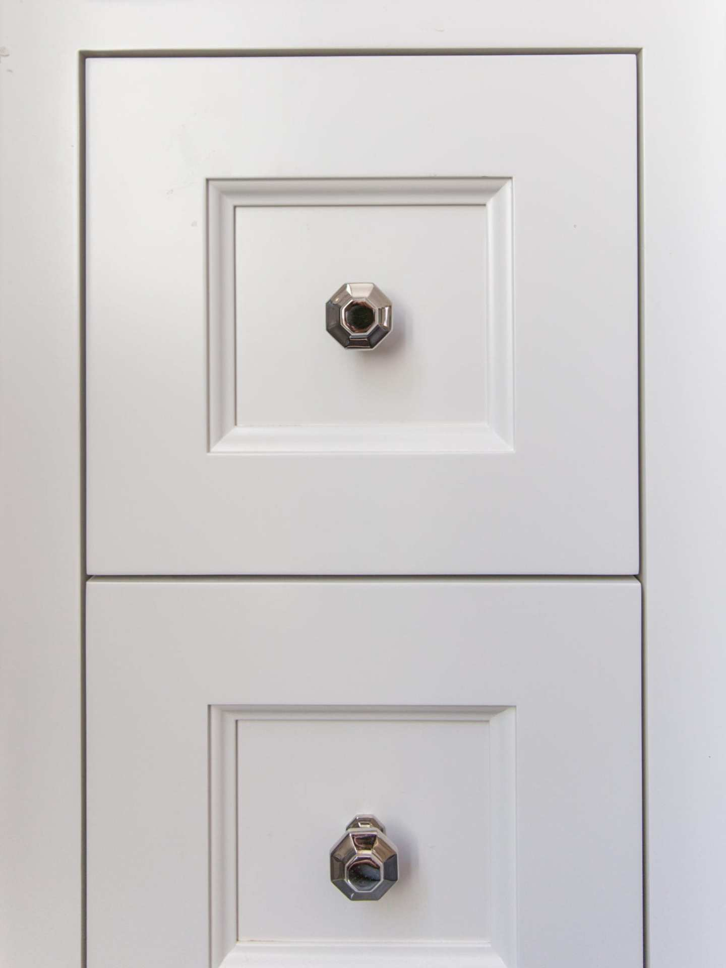 Unique pulls for bathroom. Hexagon pulls in polished nickel.