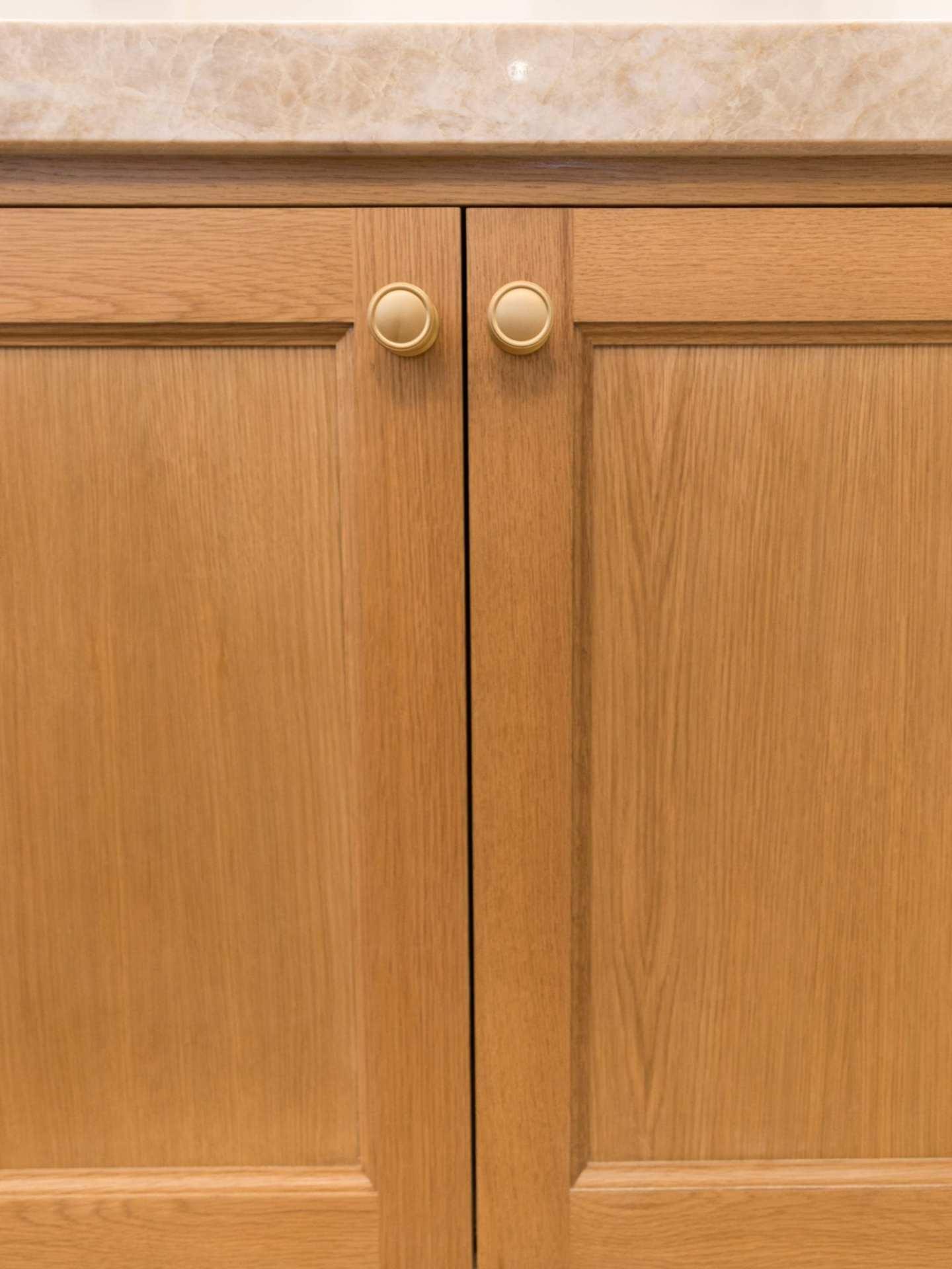 VESTA hardware Knobs on oak kitchen cabinets.