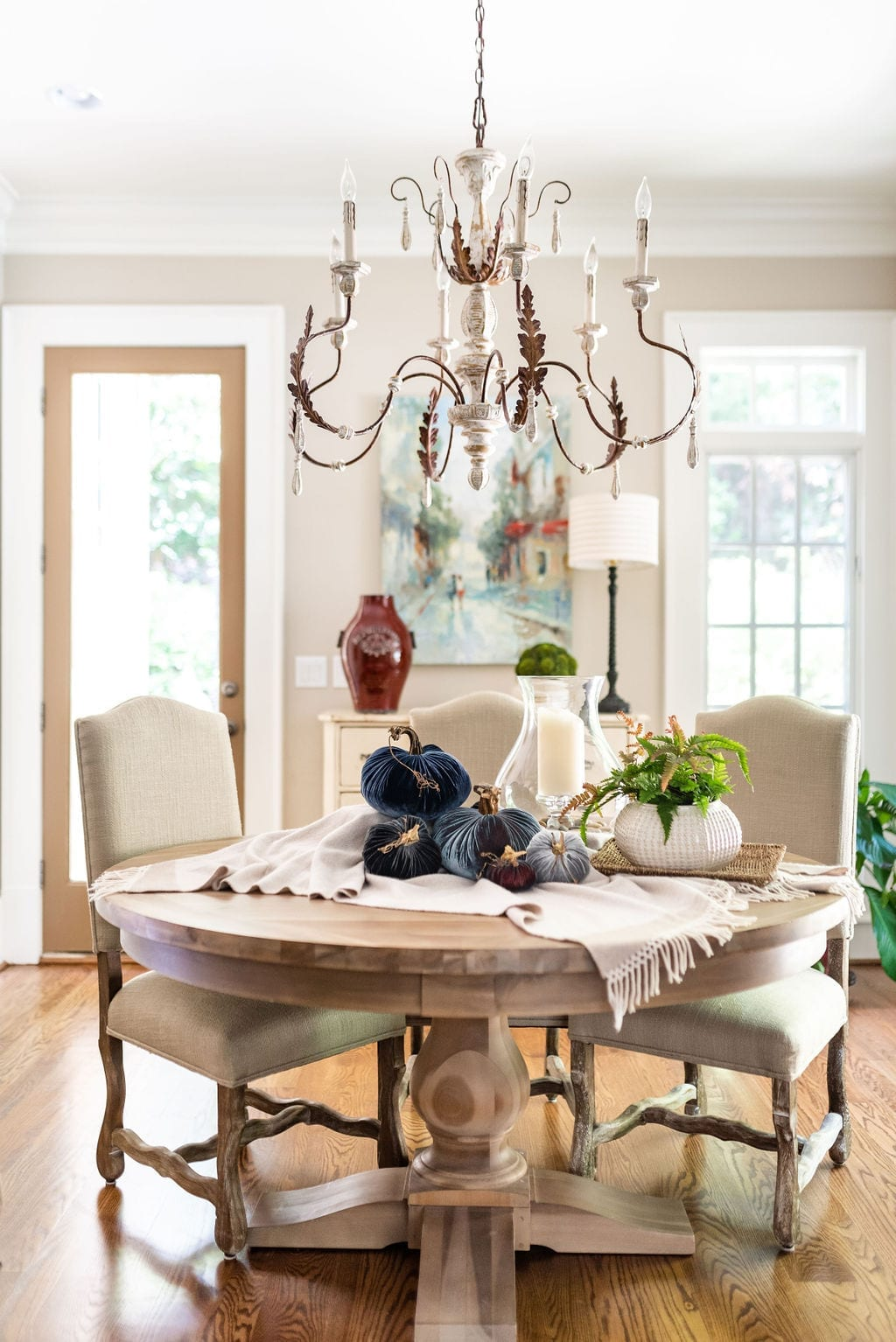 Easy Thanksgiving Centerpiece with round wood dining room table and light wood chairs.