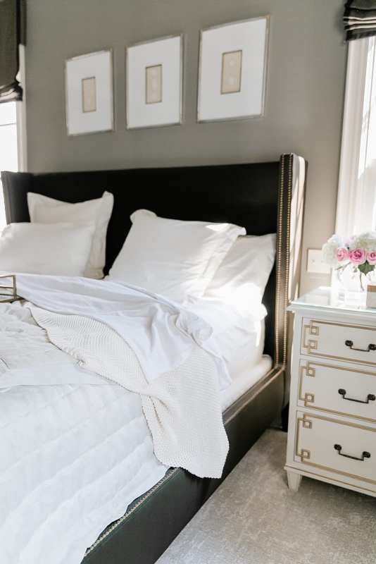 Pine Cone Hill Bedding. Master Bedroom linens in ivory. Brown silk headboard and gray walls.