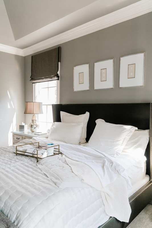 Brown and Gray Bedroom decor. Gray walls with brown bed and Annie Selkie linens. Ivory nightstand with gold metallic accents.