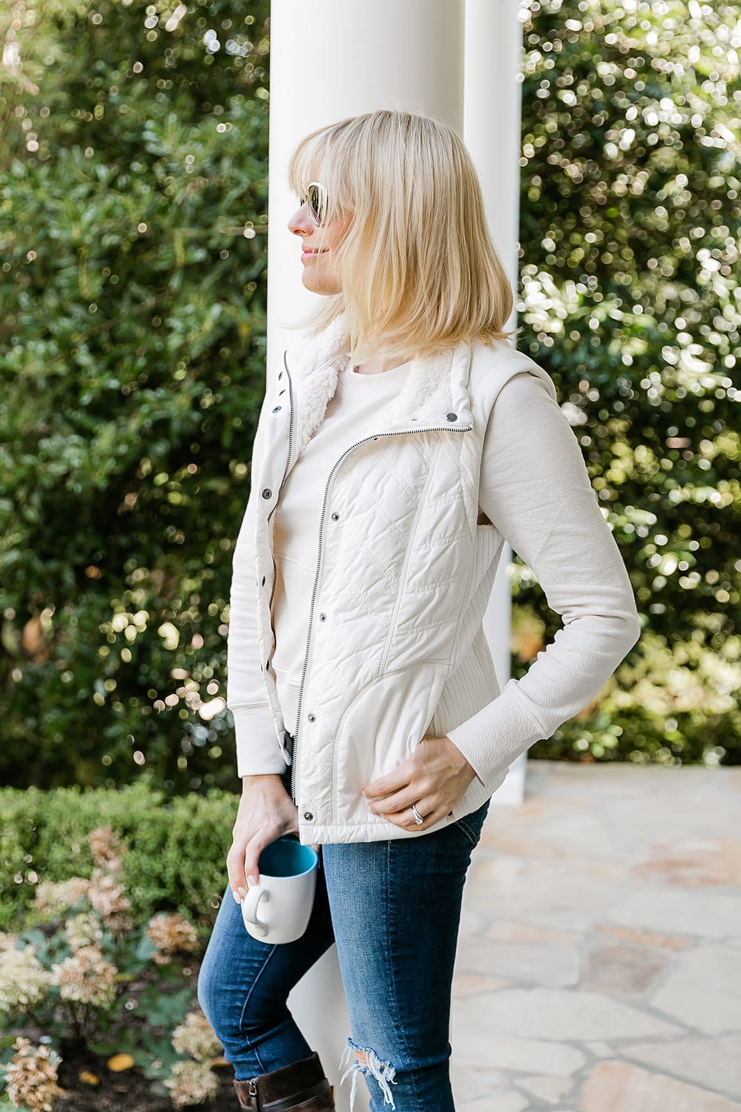 Vest and Sweatshirt Outfit in ivory and jeans.