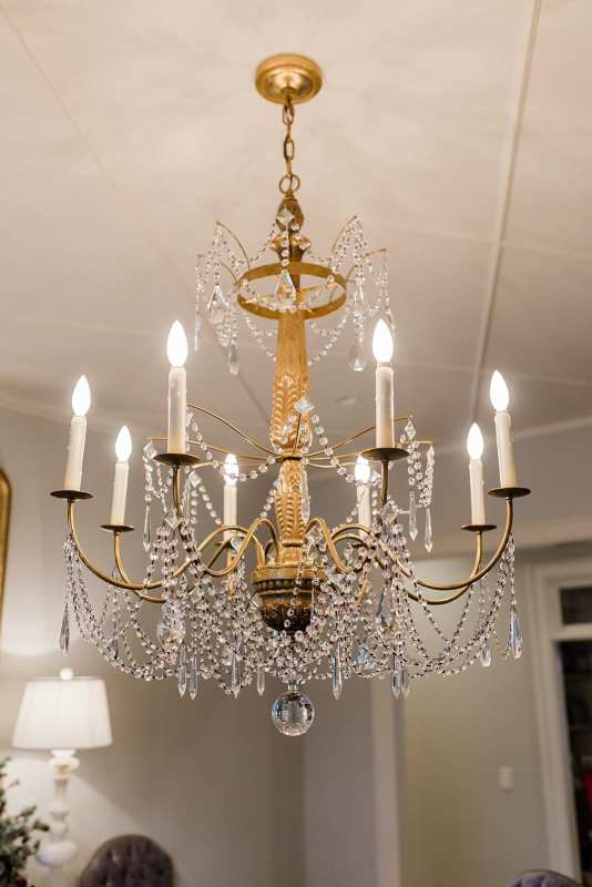 Elaborate Gold Crystal Chandelier with Dining Room ceiling trim design.