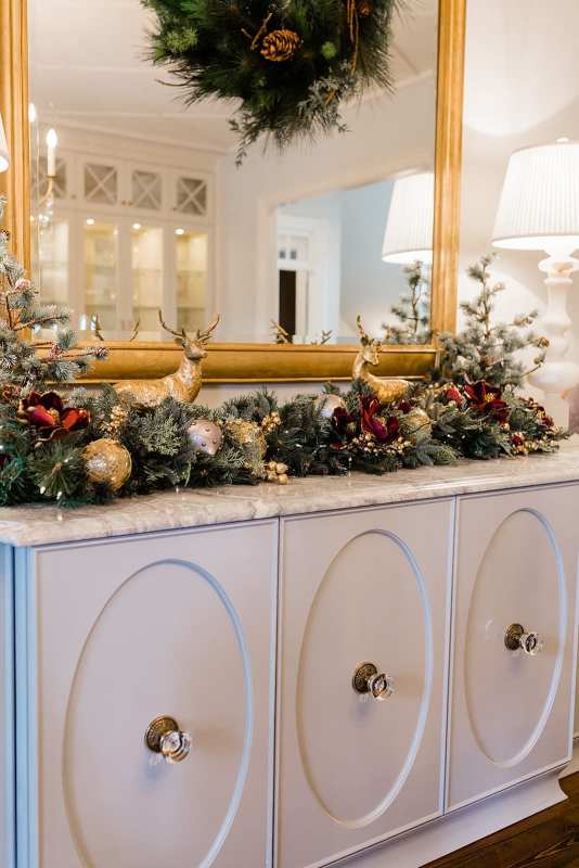 Magnolia garland for Christmas with reindeer decorations for christmas and faux flocked Christmas trees.