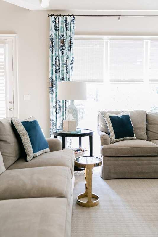 Navy Velvet Throw Pillow in blue and beige family room decor.