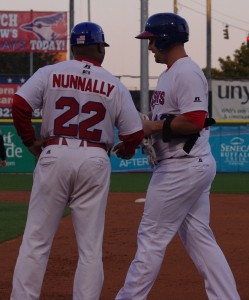 First base coach and hitting coach Jon Nunnally greets Brad Glenn at first base in Buffalo in 2013