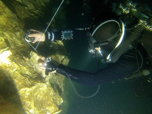 Cave diver laying line tie off