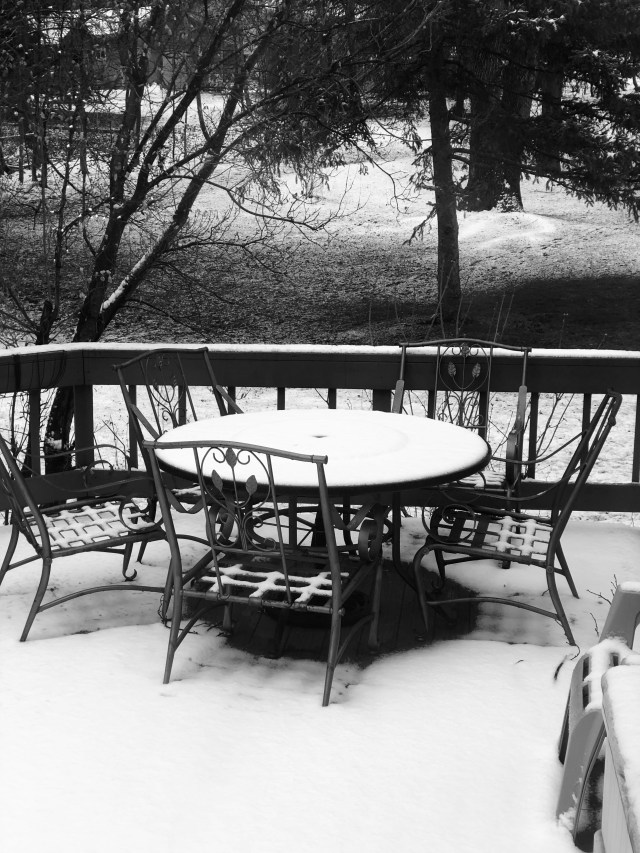 patio table covered with a dusting of snow
